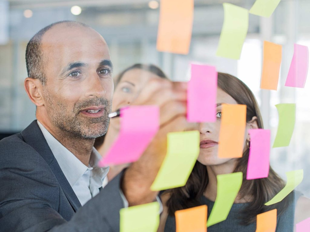 Business-Meeting-Using-Sticky-Notes